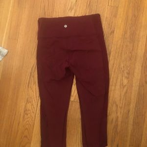 Burgundy Lululemon capris with side detailing